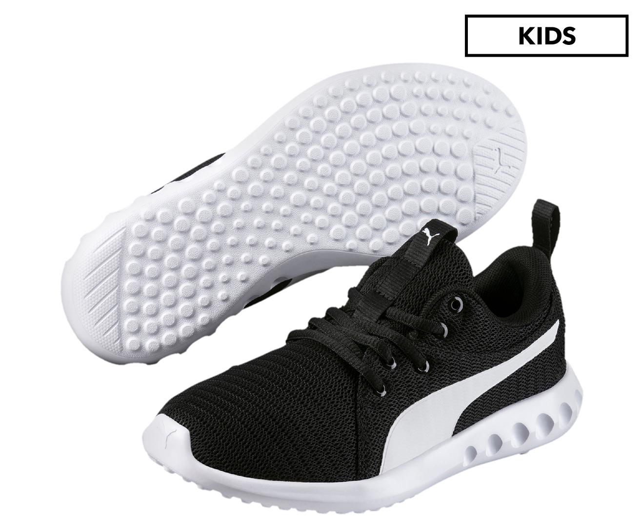 5c0d82dbfd7e PUMA Grade-School Boys  Carson 2 JR Training Shoe - Puma Black Puma White