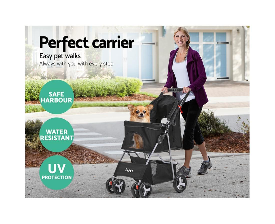 Dog inside a black dog stroller